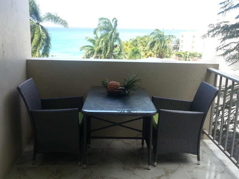 Outdoor Dining on Balcony of Ocean front Montego Bay Club #508